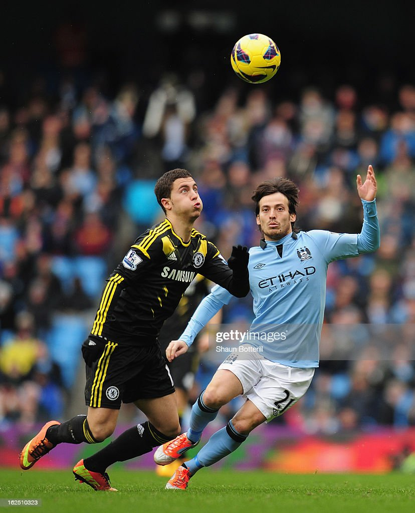 Eden Hazard of Chelsea and David Silva of Manchester City challenge for the ball during the Barclays Premier League match between Manchester City and Chelsea at Etihad Stadium on February 24, 2013 in Manchester, England.