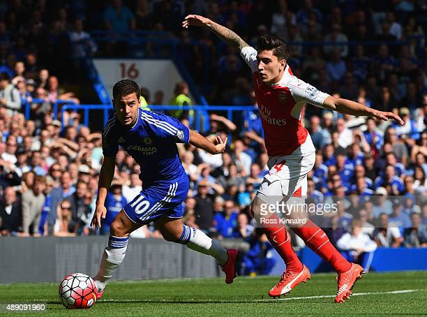 Eden Hazard of Chelsea and Hector Bellerin of Arsenal compete for the ball during the Barclays Premier League match between Chelsea and Arsenal at...