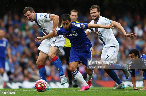 Eden Hazard of Chelsea and James McArthur and Yohan Cabaye of Crystal Palace in action during the Barclays Premier League match between Chelsea and...
