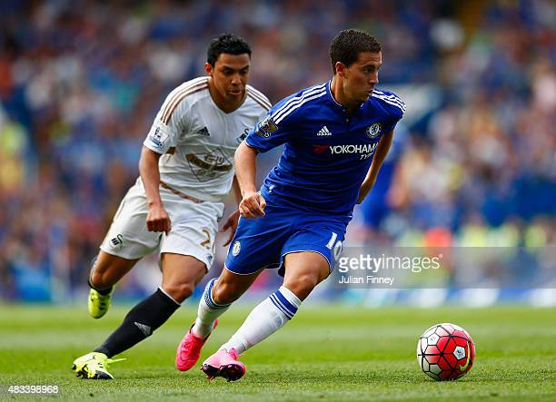 Eden Hazard of Chelsea and Jefferson Montero of Swansea City compete for the ball during the Barclays Premier League match between Chelsea and...