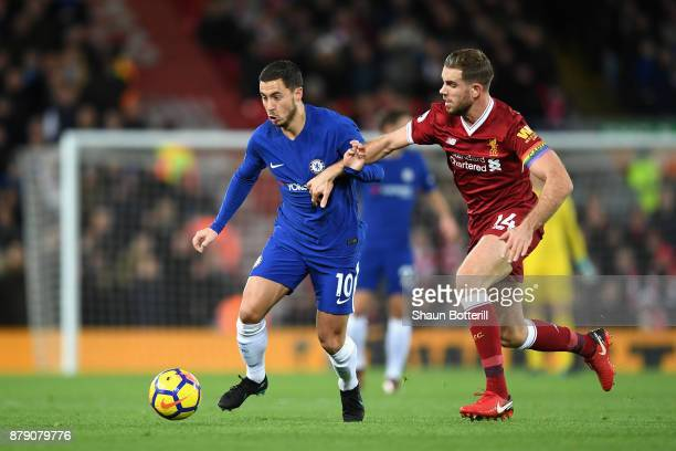 Eden Hazard of Chelsea and Jordan Henderson of Liverpool battle for possession during the Premier League match between Liverpool and Chelsea at...