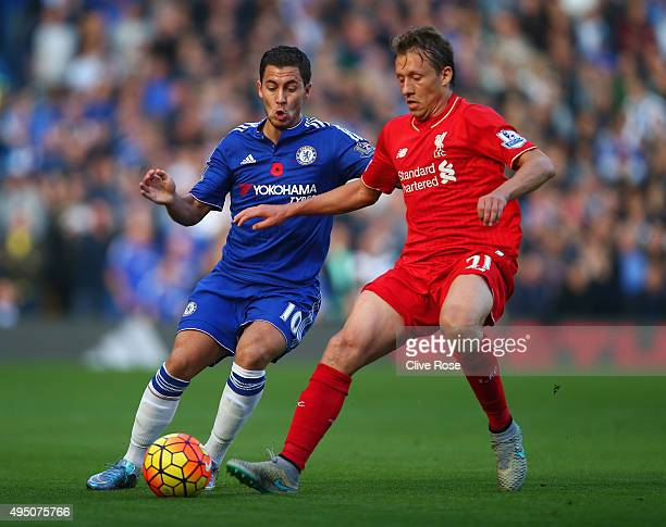Eden Hazard of Chelsea and Lucas Leiva of Liverpool compete for the ball during the Barclays Premier League match between Chelsea and Liverpool at...