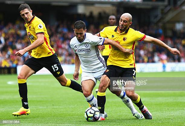 Eden Hazard of Chelsea and Nordin Amrabat of Watford battle for possession during the Premier League match between Watford and Chelsea at Vicarage...