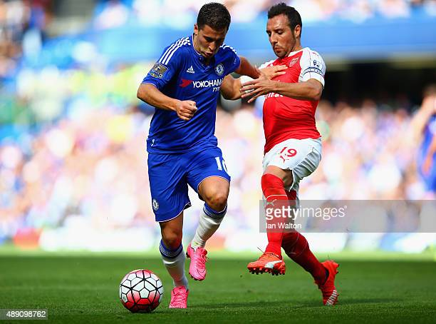 Eden Hazard of Chelsea and Santi Cazorla of Arsenal compete for the ball during the Barclays Premier League match between Chelsea and Arsenal at...