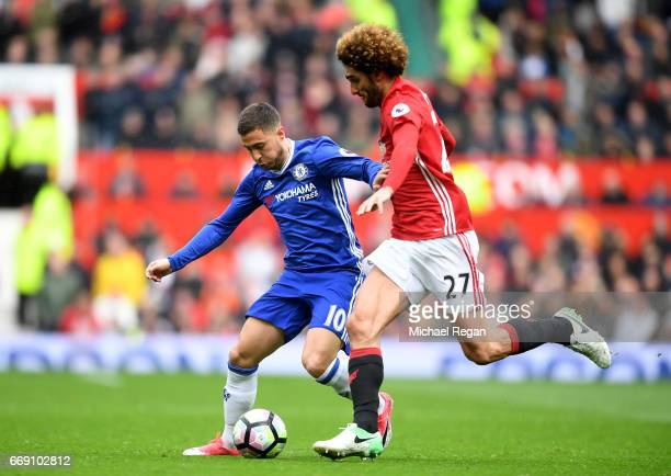 Eden Hazard of Chelsea attempts to take the ball past Marouane Fellaini of Manchester United during the Premier League match between Manchester...