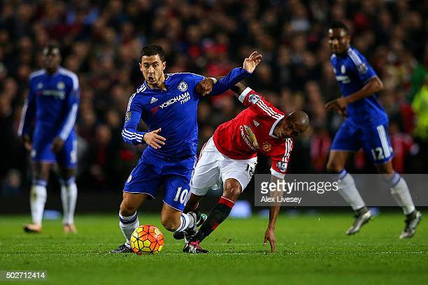 Eden Hazard of Chelsea battles for the ball with Ashley Young of Manchester United during the Barclays Premier League match between Manchester United...