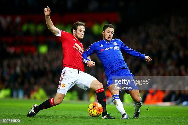 Eden Hazard of Chelsea battles for the ball with Daley Blind of Manchester United during the Barclays Premier League match between Manchester United...
