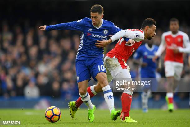 Eden Hazard of Chelsea battles for the ball with Francis Coquelin of Arsenal during the Premier League match between Chelsea and Arsenal at Stamford...