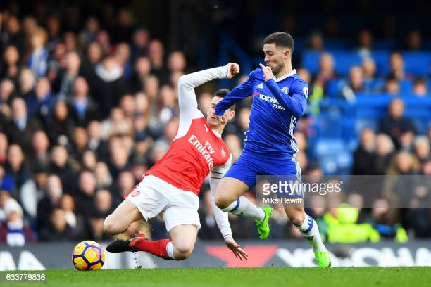 Eden Hazard of Chelsea battles for the ball with Laurent Koscielny of Arsenal during the Premier League match between Chelsea and Arsenal at Stamford...