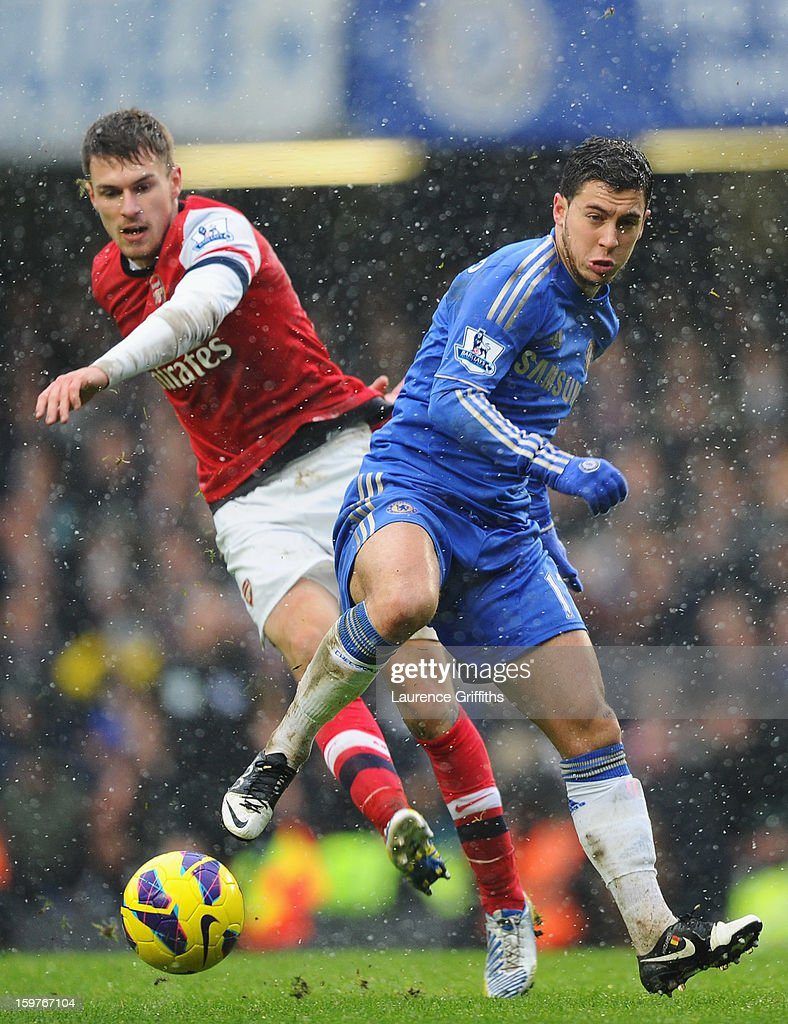 Eden Hazard of Chelsea battles with Aaron Ramsey of Arsenal during the Barclays Premier League match between Chelsea and Arsenal at Stamford Bridge on January 20, 2013 in London, England.