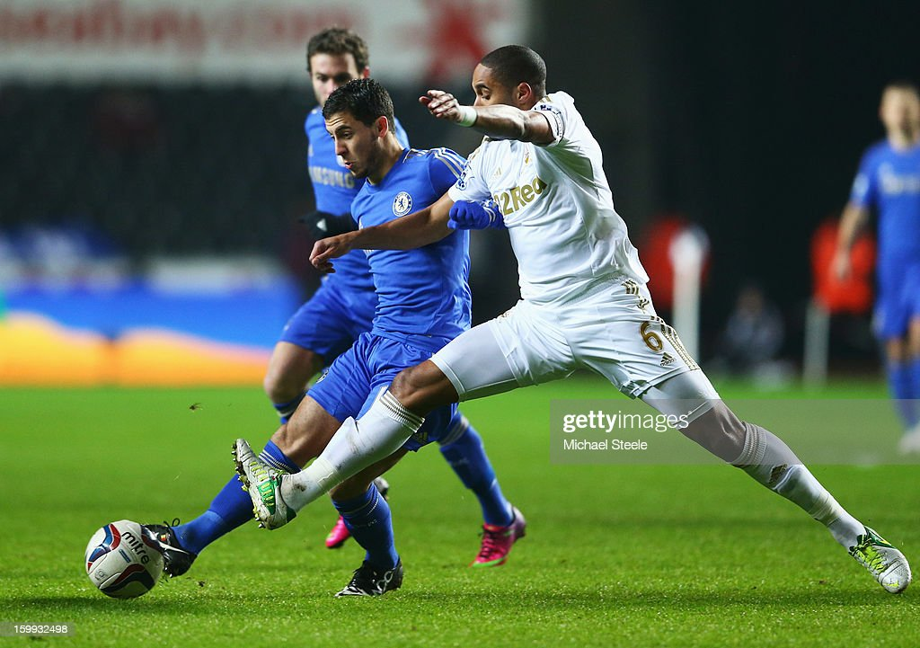 Eden Hazard of Chelsea battles with Ashley Williams of Swansea City during the Capital One Cup Semi-Final Second Leg match between Swansea City and Chelsea at Liberty Stadium on January 23, 2013 in Swansea, Wales.