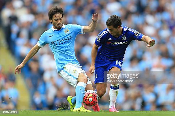 Eden Hazard of Chelsea battles with David Silva of Man City during the Barclays Premier League match between Manchester City and Chelsea at the...