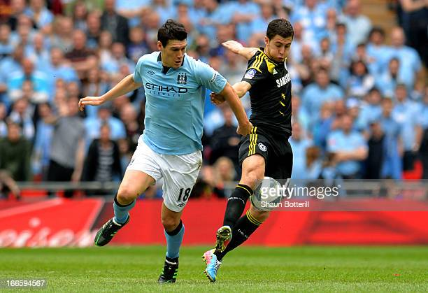 Eden Hazard of Chelsea battles with Gareth Barry of Manchester City during the FA Cup with Budweiser Semi Final match between Chelsea and Manchester...