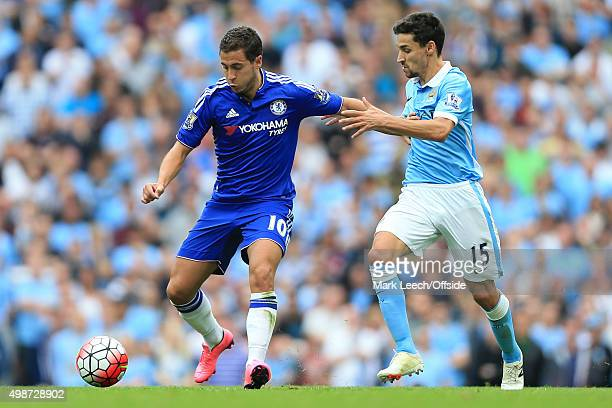 Eden Hazard of Chelsea battles with Jesus Navas of Man City during the Barclays Premier League match between Manchester City and Chelsea at the...
