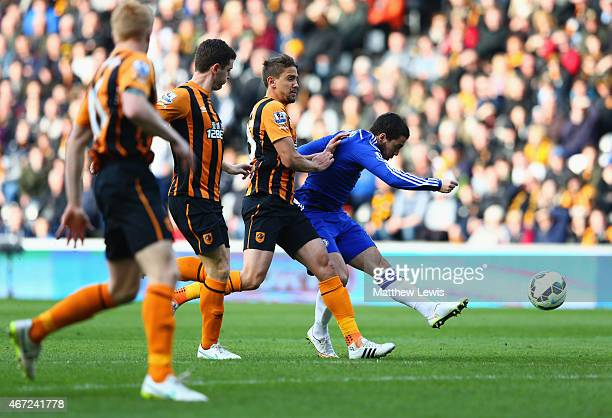 Eden Hazard of Chelsea beats the Hull City defence to score their first goal during the Barclays Premier League match between Hull City and Chelsea...