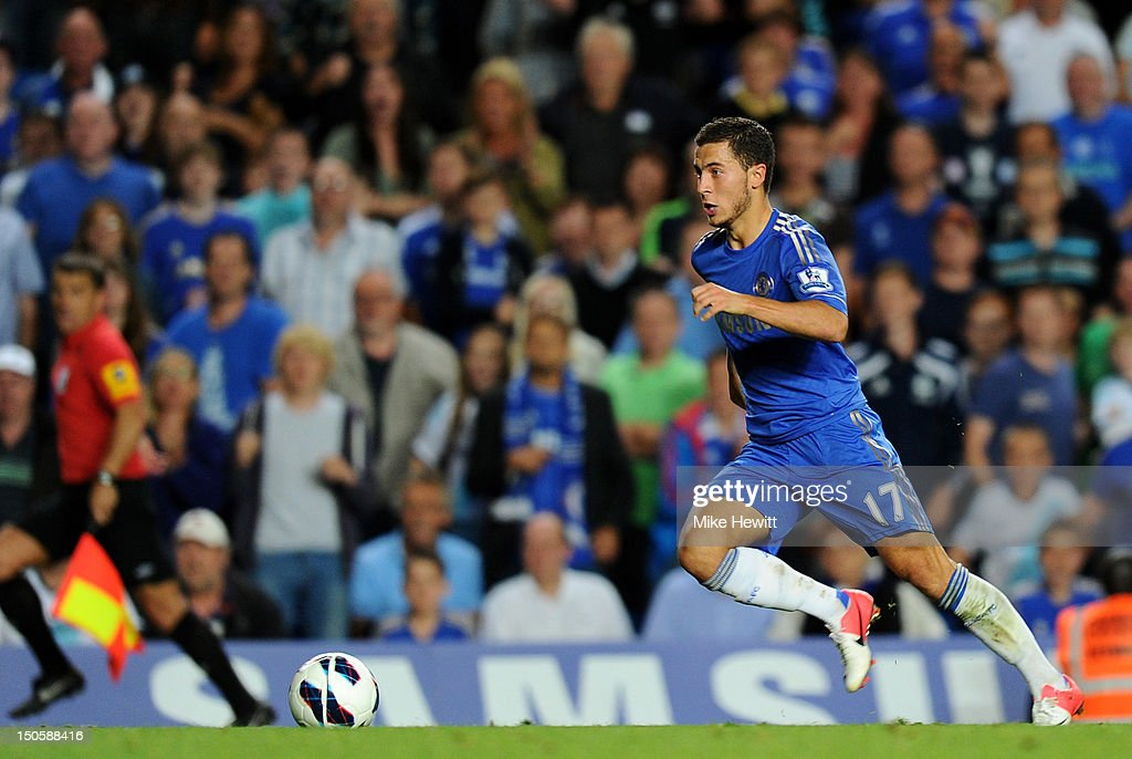 <a gi-track='captionPersonalityLinkClicked' href=/galleries/search?phrase=Eden+Hazard&family=editorial&specificpeople=5539543 ng-click='$event.stopPropagation()'>Eden Hazard</a> of Chelsea breaks with the ball to run through and set up Branislav Ivanovic of Chelsea for the fourth goal during the Barclays Premier League match between Chelsea and Reading at Stamford Bridge on August 22, 2012 in London, England.