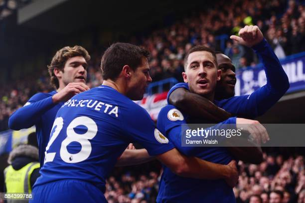 Eden Hazard of Chelsea celebrates after scoring his sides first goal with his team mates during the Premier League match between Chelsea and...