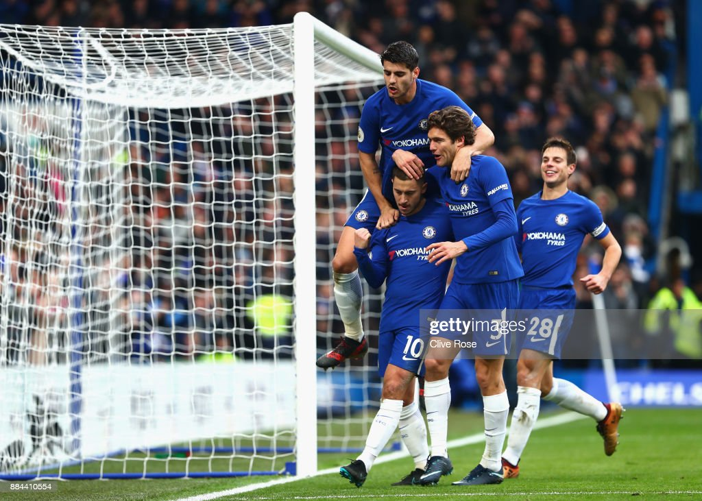 Eden Hazard of Chelsea celebrates after scoring his sides third goal with Alvaro Morata of Chelsea and Marcos Alonso of Chelsea during the Premier League match between Chelsea and Newcastle United at Stamford Bridge on December 2, 2017 in London, England.