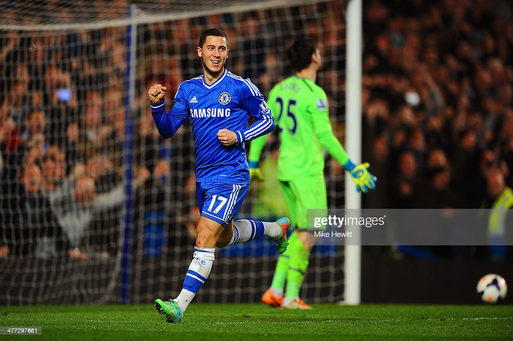 Eden Hazard of Chelsea celebrates after scoring his team's second goal from the penalty spot past goalkeeper Hugo Lloris of Spurs during the Barclays Premier League match between Chelsea and Tottenham Hotspur at Stamford Bridge on March 8, 2014 in London, England.