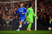 Eden Hazard of Chelsea celebrates after scoring his team's second goal from the penalty spot past goalkeeper Hugo Lloris of Spurs during the Barclays...