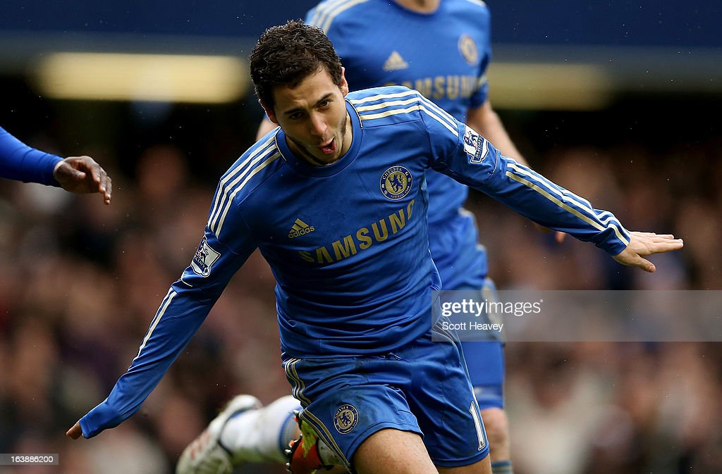 <a gi-track='captionPersonalityLinkClicked' href=/galleries/search?phrase=Eden+Hazard&family=editorial&specificpeople=5539543 ng-click='$event.stopPropagation()'>Eden Hazard</a> of Chelsea celebrates after scoring their second goal in action during the Barclays Premier League match between Chelsea and West Ham United at Stamford Bridge on March 17, 2013 in London, England.
