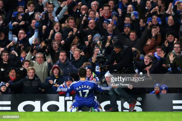 Eden Hazard of Chelsea celebrates in front of the fans after scoring a goal to level the scores at 11 during the Barclays Premier League match...