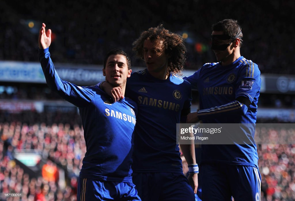 Eden Hazard (L) of Chelsea celebrates scoring his penalty during the Barclays Premier League match between Liverpool and Chelsea at Anfield on April 21, 2013 in Liverpool, England.