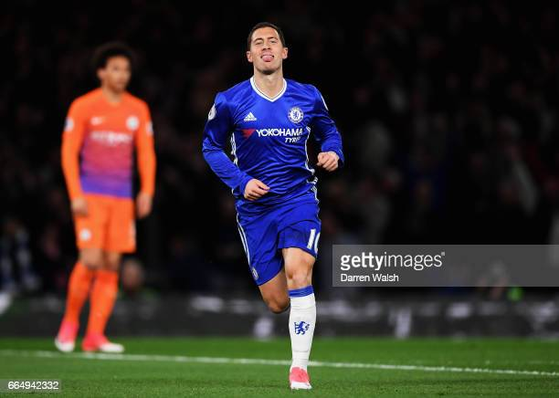 Eden Hazard of Chelsea celebrates scoring his sides first goal during the Premier League match between Chelsea and Manchester City at Stamford Bridge...