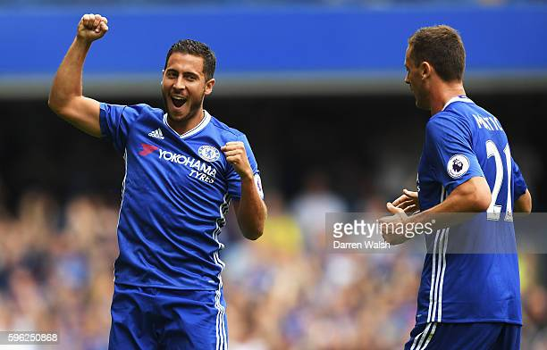 Eden Hazard of Chelsea celebrates scoring his sides first goal with his team mate Nemanja Matic of Chelsea during the Premier League match between...