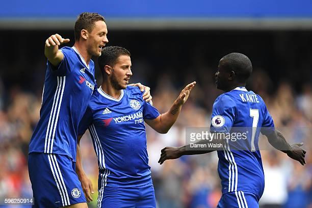 Eden Hazard of Chelsea celebrates scoring his sides first goal with his team mates Nemanja Matic of Chelsea and N'Golo Kante of Chelsea during the...
