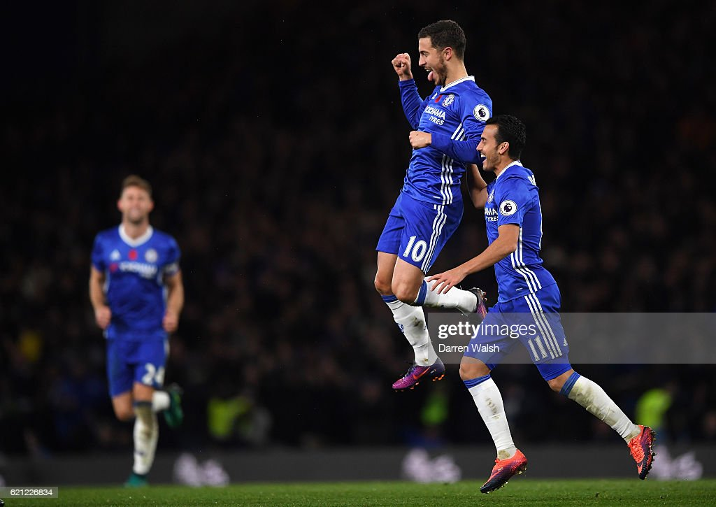 Eden Hazard of Chelsea (C) celebrates scoring his sides fourth goal with Pedro of Chelsea (R) during the Premier League match between Chelsea and Everton at Stamford Bridge on November 5, 2016 in London, England.