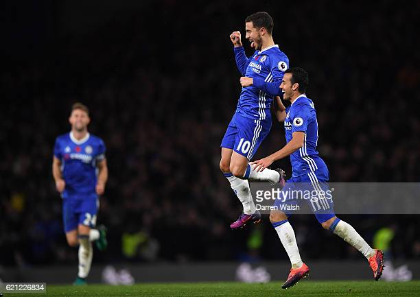 Eden Hazard of Chelsea celebrates scoring his sides fourth goal with Pedro of Chelsea during the Premier League match between Chelsea and Everton at...