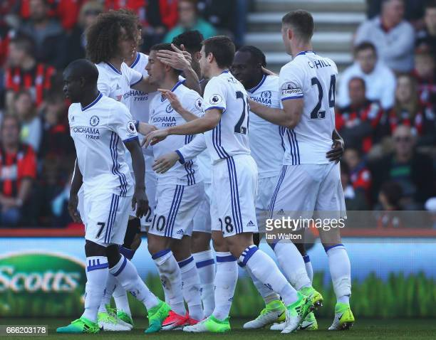 Eden Hazard of Chelsea celebrates scoring his sides second goal with his Chelsea team mates during the Premier League match between AFC Bournemouth...