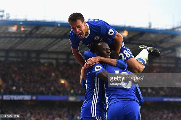 Eden Hazard of Chelsea celebrates scoring his sides third goal with his team mates Cesar Azpilicueta and Victor Moses during the Premier League match...