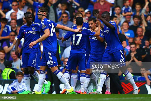 Eden Hazard of Chelsea celebrates scoring his team's second goal with his team mates during the Barclays Premier League match between Chelsea and...