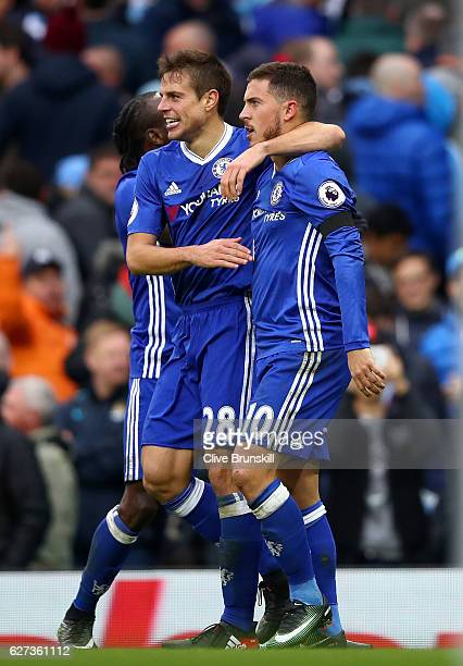 Eden Hazard of Chelsea celebrates scoring his team's third goal with his team mates Cesar Azpilicueta and Victor Moses of Chelsea during the Premier...