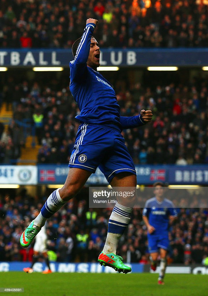 Eden Hazard of Chelsea celebrates scoring the first goal during the Barclays Premier League match between Chelsea and Swansea City at Stamford Bridge on December 26, 2013 in London, England.
