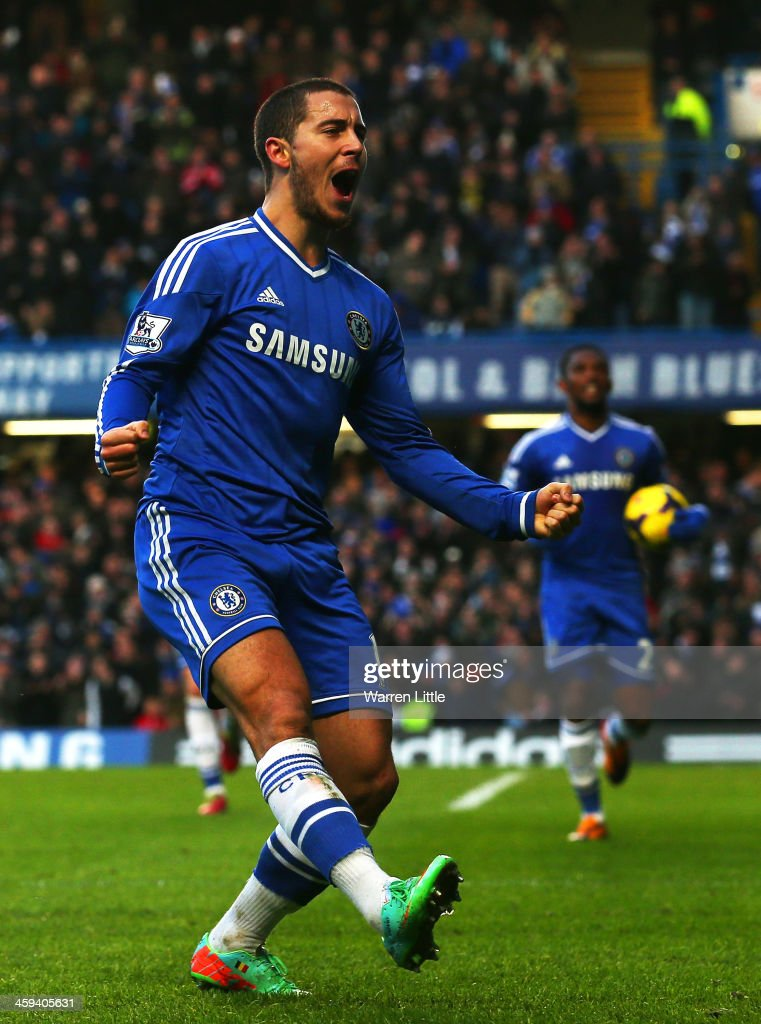 <a gi-track='captionPersonalityLinkClicked' href=/galleries/search?phrase=Eden+Hazard&family=editorial&specificpeople=5539543 ng-click='$event.stopPropagation()'>Eden Hazard</a> of Chelsea celebrates scoring the first goal during the Barclays Premier League match between Chelsea and Swansea City at Stamford Bridge on December 26, 2013 in London, England.