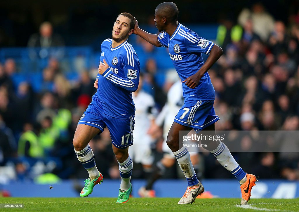 Eden Hazard of Chelsea celebrates scoring the first goal with Ramires of Chelsea during the Barclays Premier League match between Chelsea and Swansea City at Stamford Bridge on December 26, 2013 in London, England.