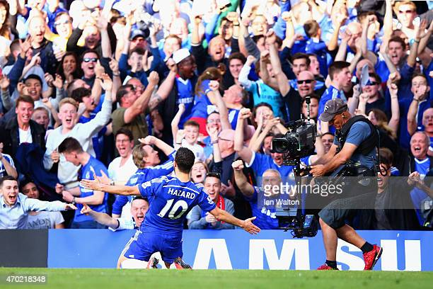 Eden Hazard of Chelsea celebrates scoring the opening goal during the Barclays Premier League match between Chelsea and Manchester United at Stamford...