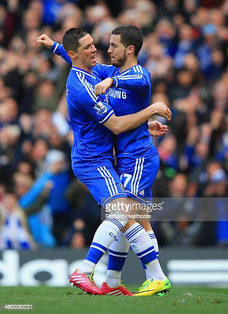 Eden Hazard of Chelsea celebrates scoring their third goal from penalty spot with Fernando Torres of Chelsea during the Barclays Premier League match...