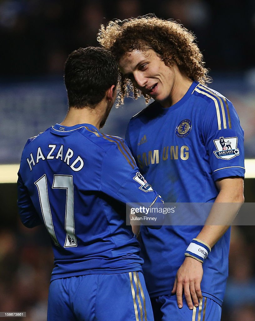Eden Hazard of Chelsea celebrates with David Luiz as he scores their seventh goal during the Barclays Premier League match between Chelsea and Aston Villa at Stamford Bridge on December 23, 2012 in London, England.