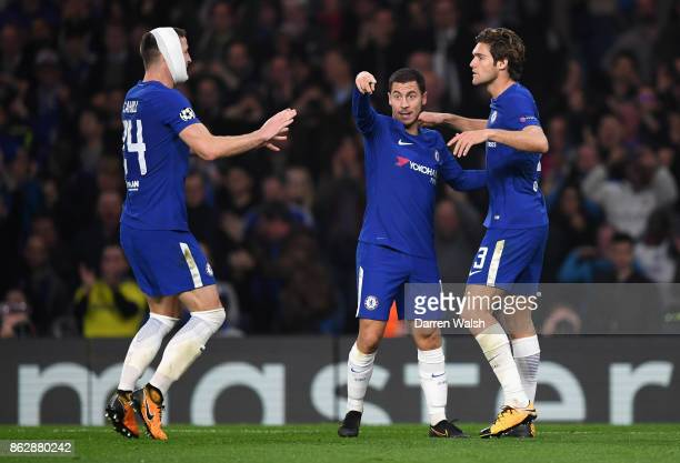 Eden Hazard of Chelsea celebrates with Gary Cahill of Cahelsea nd Marcos Alonso of Chelsea after scoring his sides third goal during the UEFA...