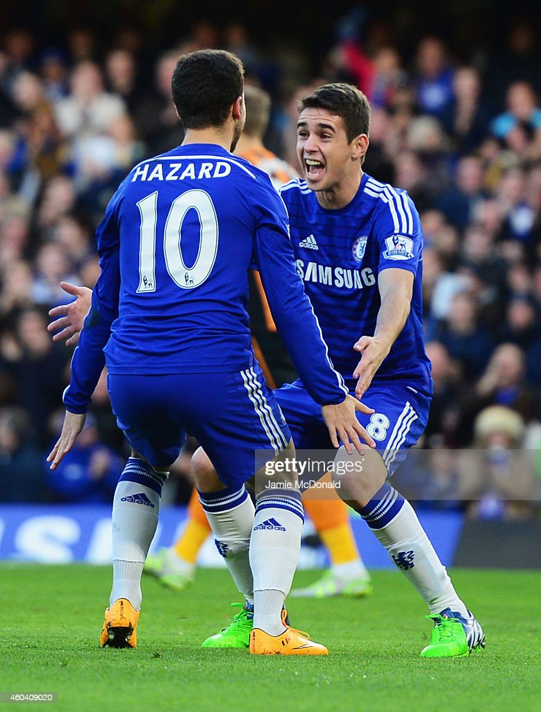 Eden Hazard of Chelsea (10) celebrates with Oscar as he scores their first goal during the Barclays Premier League match between Chelsea and Hull City at Stamford Bridge on December 13, 2014 in London, England.