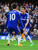 Eden Hazard of Chelsea celebrates with Oscar as he scores their first goal during the Barclays Premier League match between Chelsea and Hull City at...