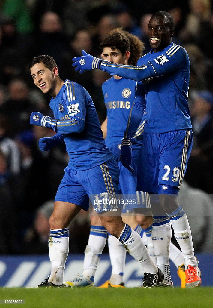 Eden Hazard of Chelsea (L) celebrates with team mate Demba Ba (R) after scoring his team's second goal of the game during the Barclays Premier League match between Chelsea and Southampton at Stamford Bridge on January 16, 2013 in London, England.
