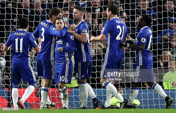 Eden Hazard of Chelsea celebrates with team mates after scoring his sides second goal during the Premier League match between Chelsea and AFC...
