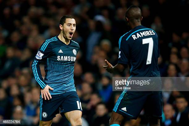 Eden Hazard of Chelsea celebrates with teammate Ramires of Chelsea after scoring the opening goal during the Barclays Premier League match between...