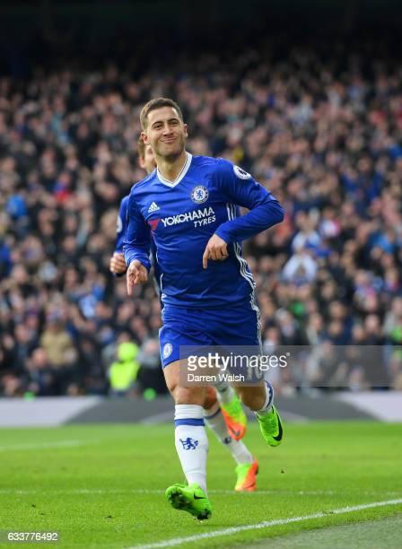 Eden Hazard of Chelsea celebrates with teammates after scoring his team's second goal during the Premier League match between Chelsea and Arsenal at...