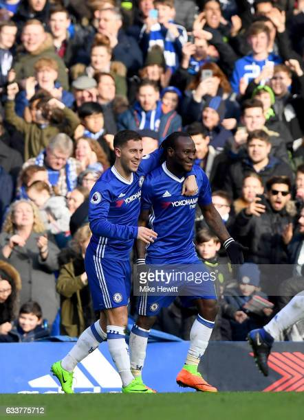 Eden Hazard of Chelsea celebrates with uteammates after scoring his team's second goal during the Premier League match between Chelsea and Arsenal at...